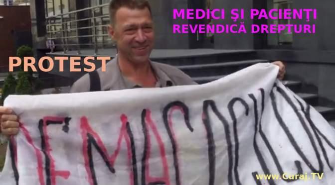 Un medic şi cîţiva pacienţi au protestat la Consiliul Concurenţei